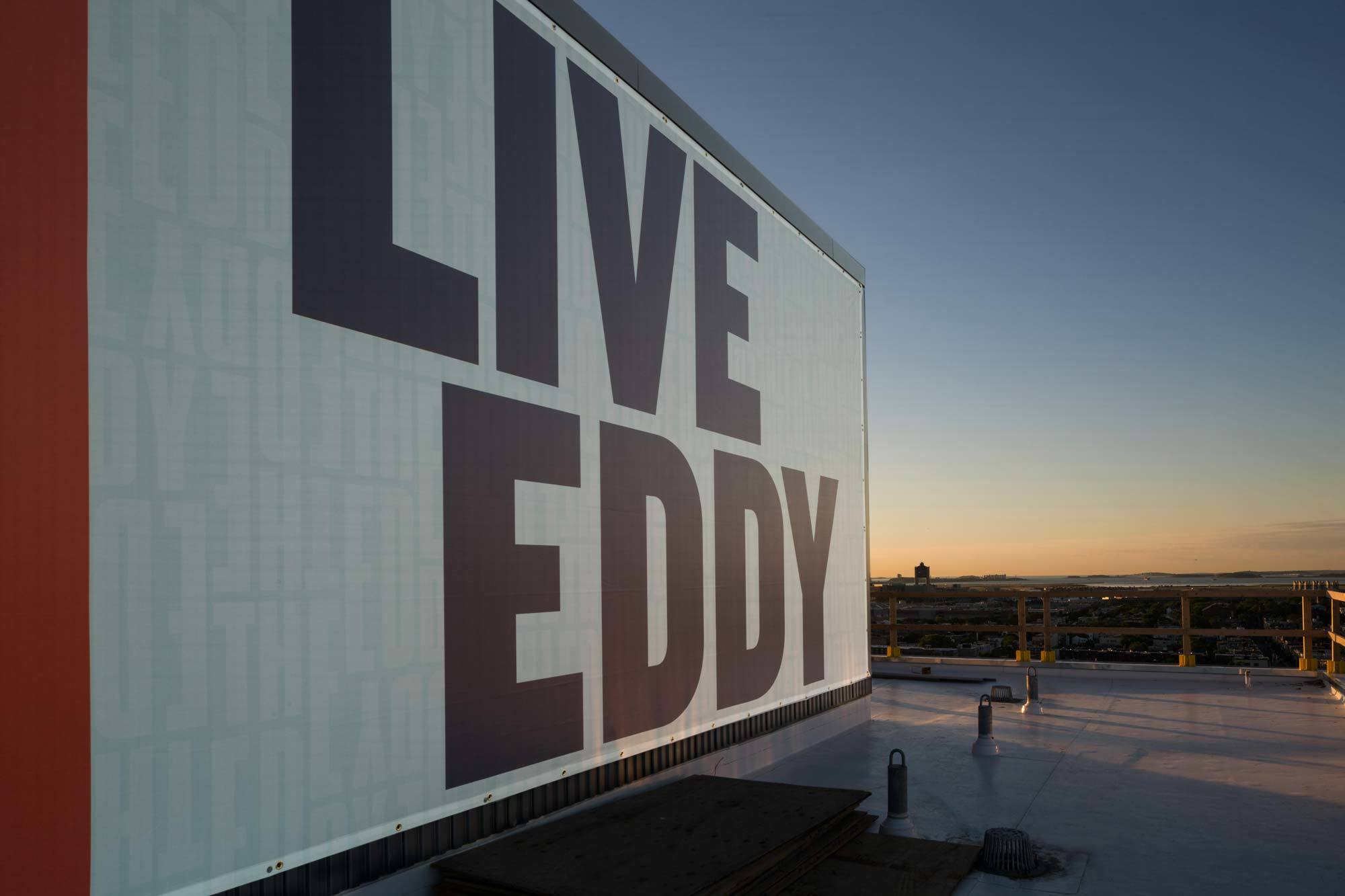 Live Eddy signage with views of water