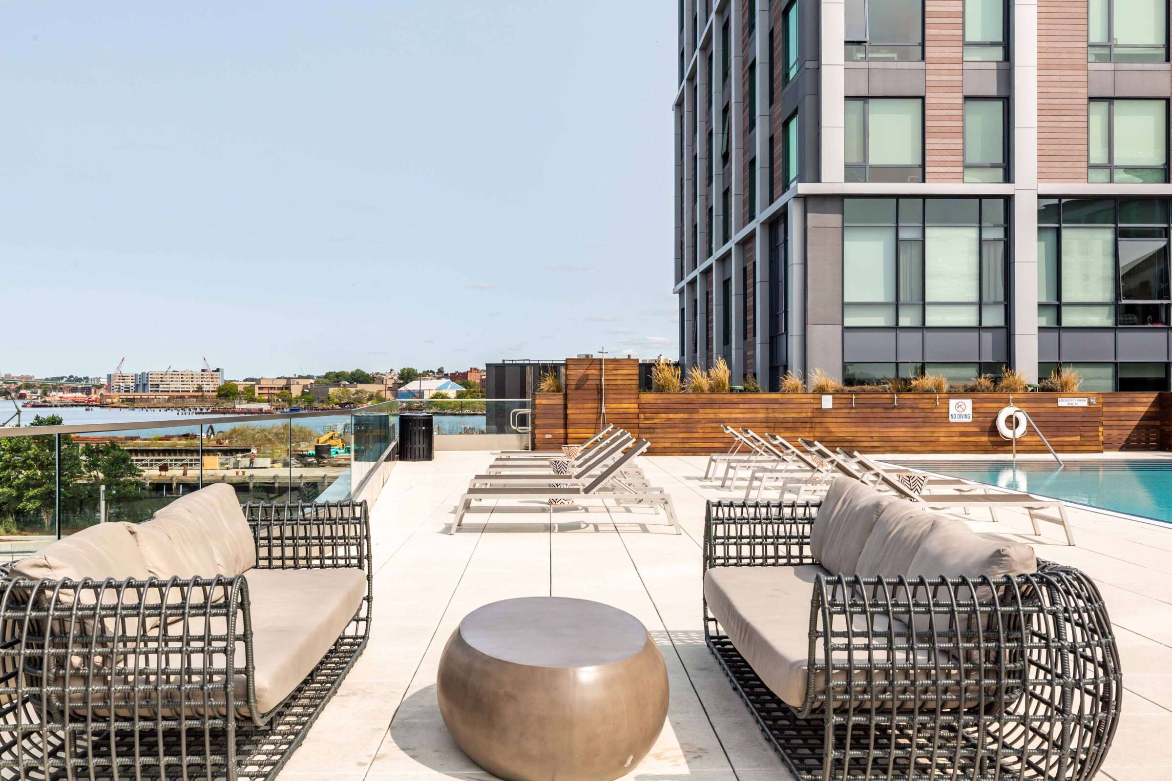 The Eddy East Boston Apartments Amenities - pool deck with lounge seating