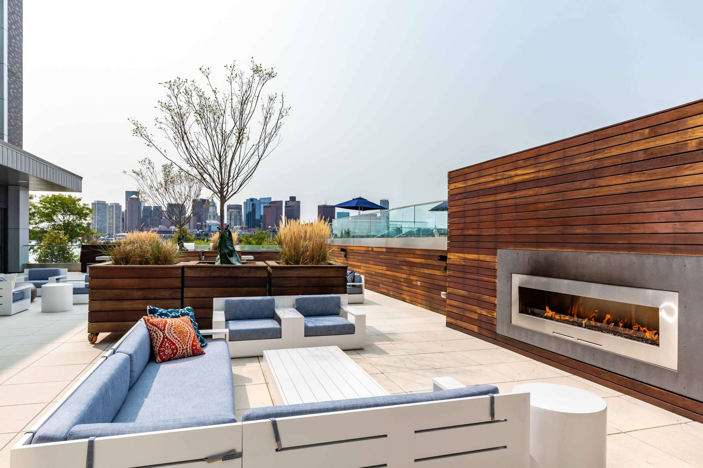 The Eddy East Boston Apartments rooftop terrace with seating and fireplace