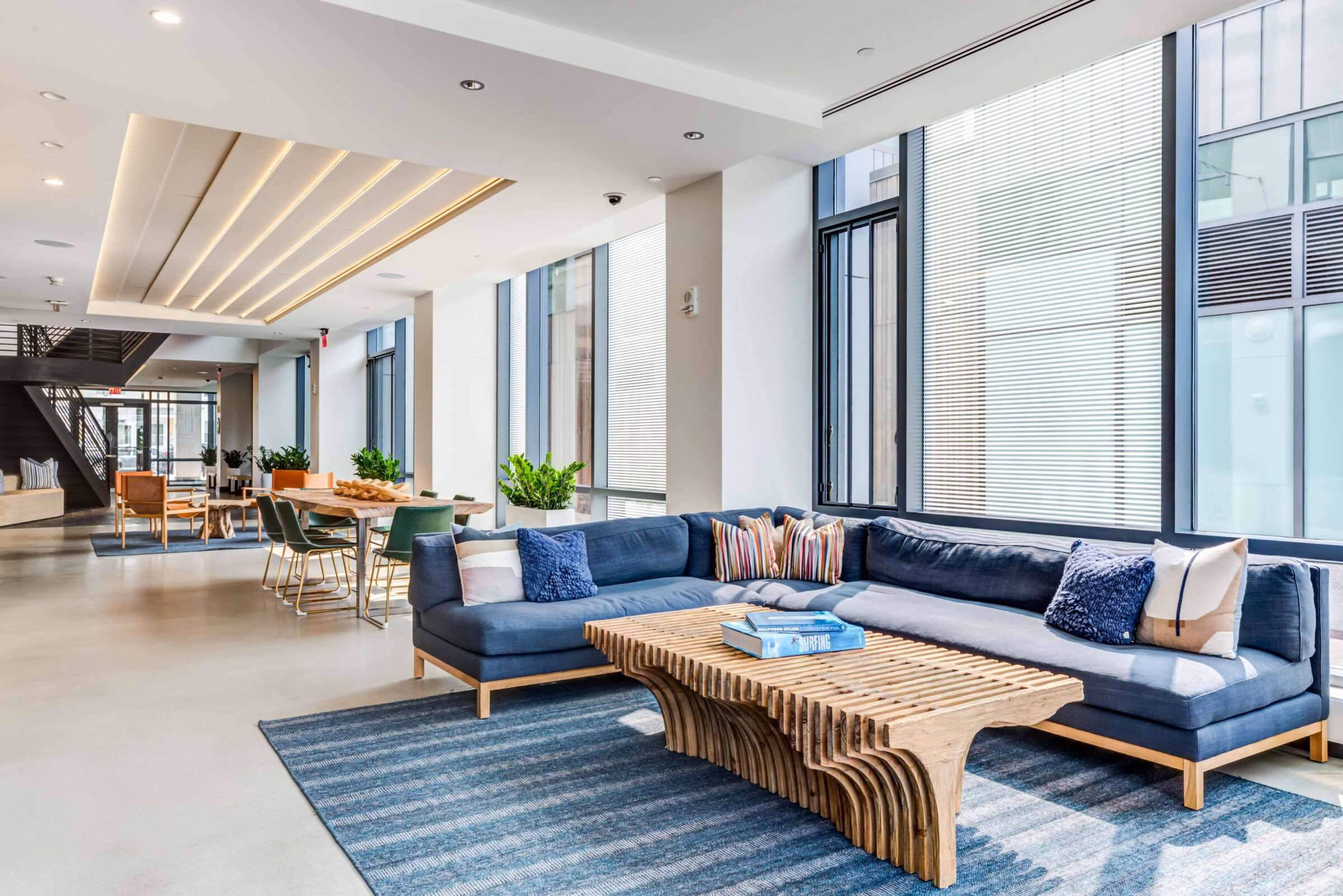 The Eddy East Boston Apartments lobby with large blue sectional couch