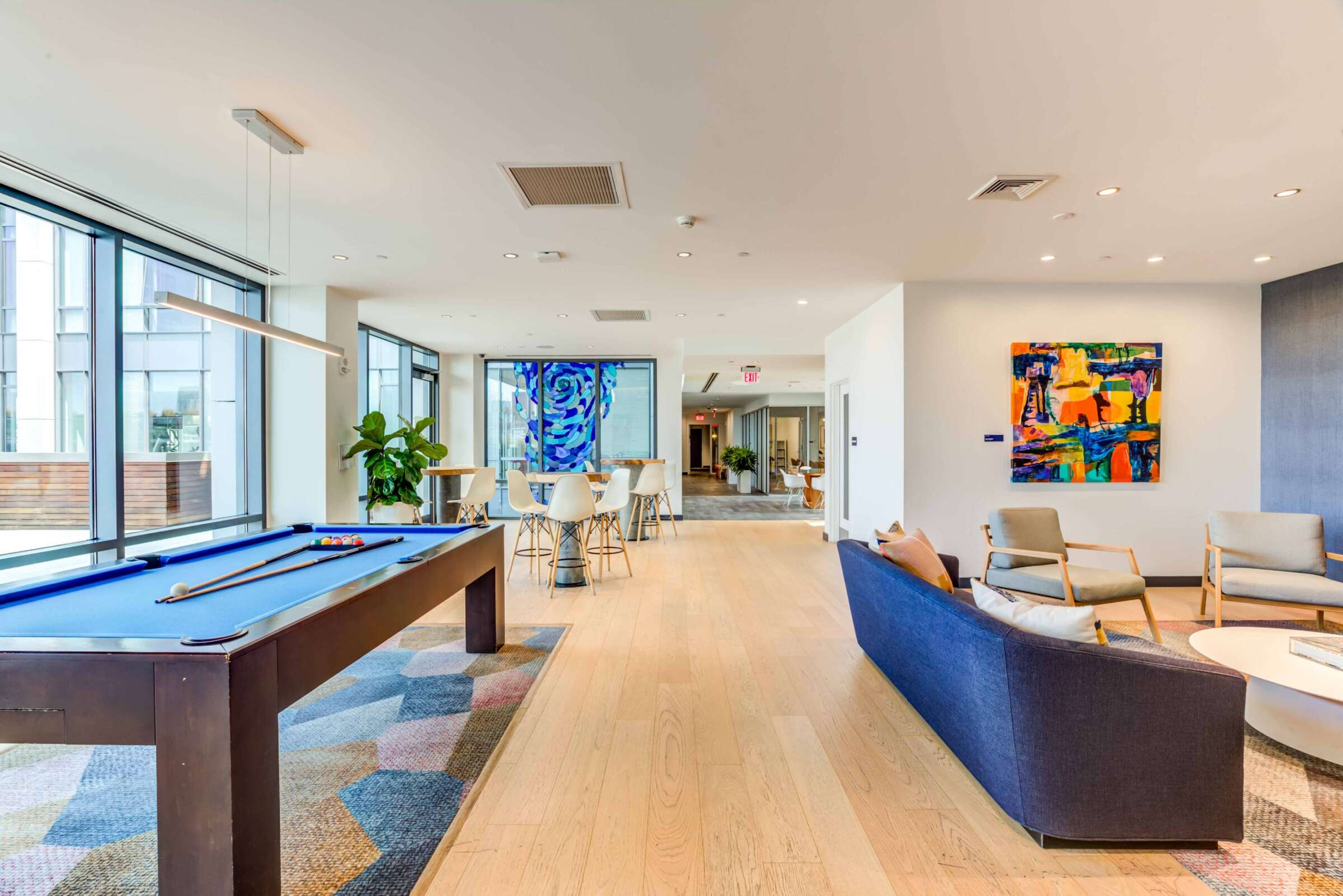 The Eddy East Boston Apartments community room with lounge seating and pool table
